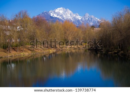 Yulong snow mountain reflection in a lake.Yulong snow mountain in Lijiang,China.There is a famous tourist attraction