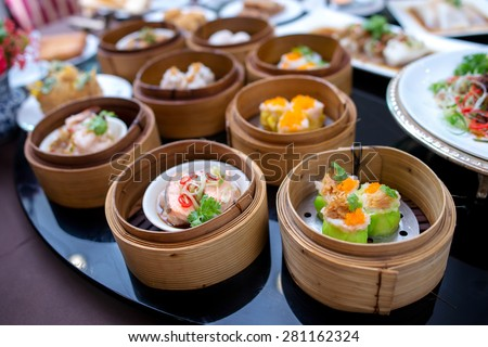 yumcha, various dim sum in bamboo steamer in chinese restaurant - stock photo