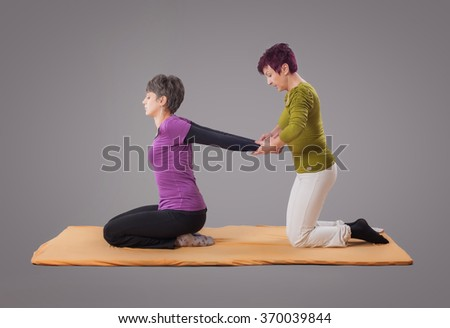 Yumeiho massage therapy. Woman getting yumeiho massage therapy in the studio - stock photo