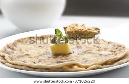 Yummy alu parathas with pickles - stock photo