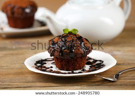 Yummy chocolate cupcake on table - stock photo
