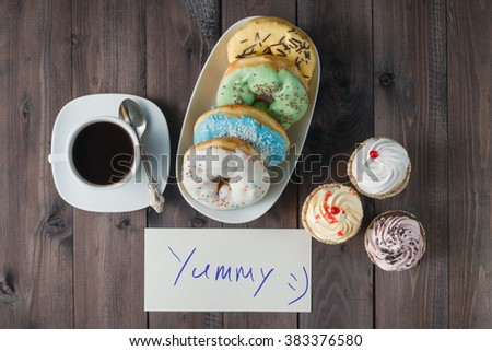 Yummy donuts. Woman hold message about donuts - stock photo