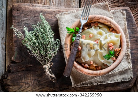 Yummy dumplings with mushrooms and onion - stock photo