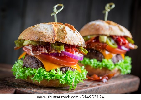 Yummy hamburger made of onion, tomato and lettuce for two