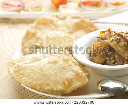 Yummy puri with potato dum curry - stock photo
