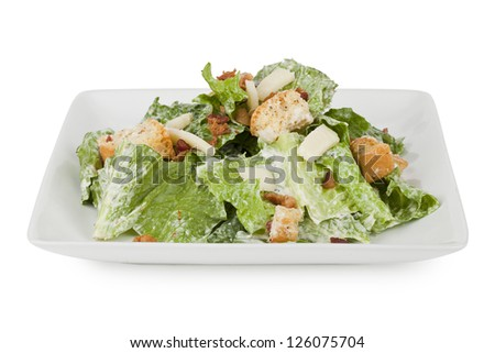 Yummy serving of Caesar salad on platter isolated in a white background - stock photo