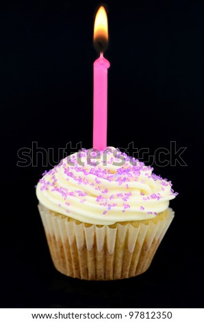 Yummy small cupcakes in the studio - stock photo