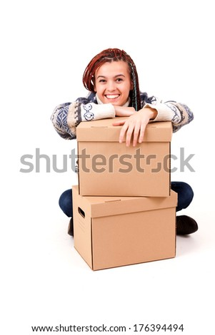 yuong woman with carton boxes, white background - stock photo