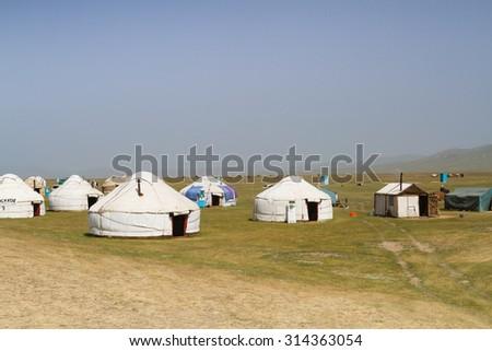 Yurt at Song Kol lake in Kyrgyzstan mountains. Central Asia - stock photo