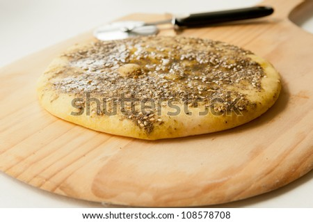 za'atar flat bread, a lebanese or turkish bread made with sumac, sunflower seeds and thyme with olive oil on top. - stock photo