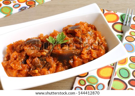 Zaalouk, a traditional Moroccan eggplant and tomato salad eaten as a side dish or as a dip with warm bread, meat or fish - stock photo