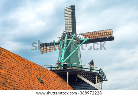Zaandam, Holland - July 25, 2014: Waterland district, a worker in the famous area of the mills