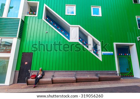 ZAANDAM, NETHERLANDS - SEPTEMBER 02, 2015: part of the city hall in Zaandam with unidentified people. Together with the near Inntel Hotel it is an architectural ensemble, designed by WAM architects. - stock photo