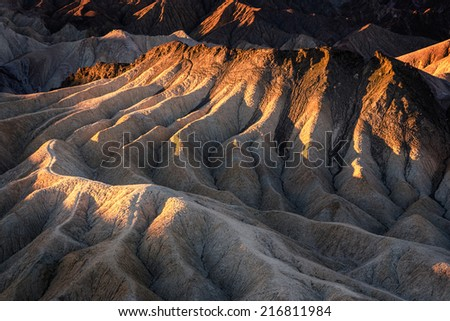 Zabriskie Point at sunrise in Death Valley National Park, California - stock photo