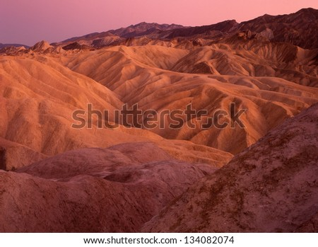 Zabriskie Point, Furnace Creek, Death Valley National Park, CA/Zabriskie Point #2/ The ruts and crevices at Zabriskie Point make good sunrise photos and great hiking trails. - stock photo