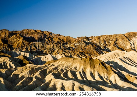 Zabriskie Point is a part of Amargosa Range located in east of Death Valley in Death Valley National Park in the United States noted for its erosional landscape - stock photo