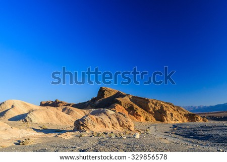 Zabriskie Point is a part of Amargosa Range located in east of Death Valley in Death Valley National Park in the United States noted for its erosional landscape. - stock photo