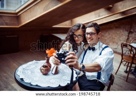 zadumchyvi and happy boy with girl - stock photo