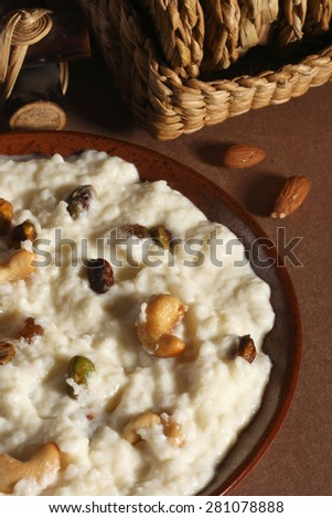 Zafrani kheer - Saffron flavored sweetened milk with rice, ghee and garnished with dry fruits - stock photo