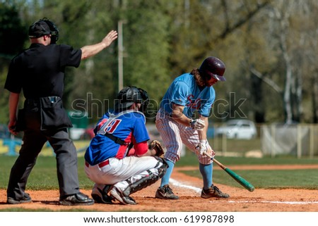 ZAGREB, CROATIA - APRIL 01, 2017: Baseball match, Baseball Club Zagreb vs. Baseball Club Nada Split. Baseball batter catcher and Plate umpire on play field
