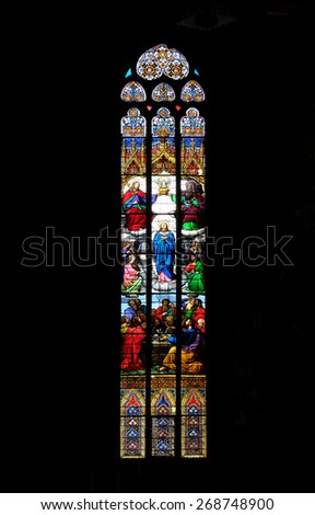 ZAGREB, CROATIA - APRIL 04: Coronation of the Virgin Mary, stained glass in Zagreb cathedral dedicated to the Assumption of Mary and to kings Saint Stephen and Ladislaus in Zagreb on April 04, 2015 - stock photo