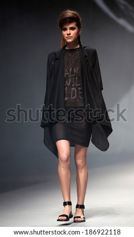 "ZAGREB, CROATIA - APRIL 10: Fashion model wears clothes made by Etna Maar on ""CRO A PORTER"" show on April 10, 2014 in Zagreb, Croatia"
