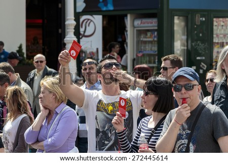 ZAGREB, CROATIA - APRIL 25, 2015: Man holding red card  for banks and sending kisses during a protest against rising interest on loans in Swiss francs in Croatia, Zagreb  - stock photo