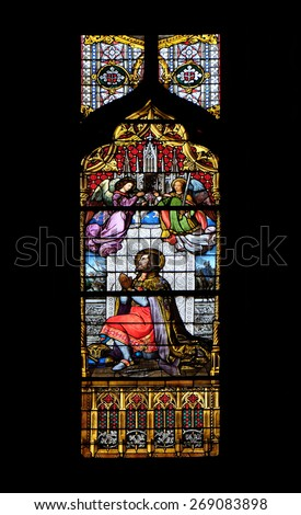 ZAGREB, CROATIA - APRIL 04: Saint Ladislaus, stained glass in Zagreb cathedral dedicated to the Assumption of Mary and to kings Saint Stephen and Saint Ladislaus in Zagreb on April 04, 2015 - stock photo