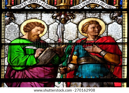 ZAGREB, CROATIA - APRIL 04: St Mark and St Demetrius, stained glass in Zagreb cathedral dedicated to the Assumption of Mary and to kings Saint Stephen and Saint Ladislaus in Zagreb on April 04, 2015 - stock photo