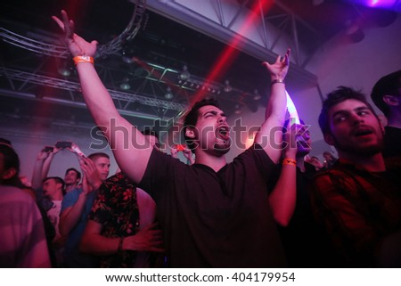 ZAGREB, CROATIA - APRIL 9, 2016 : The audience with hands up on La Fiesta Stage by Sensation party in Hypo center in Zagreb, Croatia. - stock photo