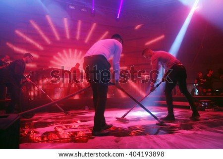 ZAGREB, CROATIA - APRIL 9, 2016 : The male staff vacuuming after performance on La Fiesta Stage by Sensation party in Hypo center in Zagreb, Croatia. - stock photo