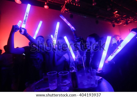 ZAGREB, CROATIA - APRIL 9, 2016 : The visitors with illuminating sticks enjoying the La Fiesta Stage by Sensation party in Hypo center in Zagreb, Croatia.