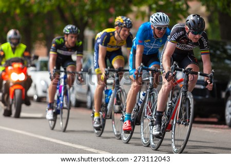 ZAGREB, CROATIA - APRIL 26, 2015: Tour of Croatia, Stage 5 in Zagreb. Group of unidentified cyclist followed by security motorcycle.