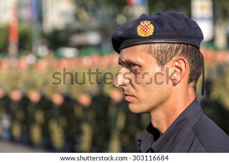 ZAGREB, CROATIA - AUGUST 4, 2015: Croatian policeman and soldiers during military parade held in celebration of 20th anniversary of liberation of Croatia. It was held along Vukovar Avenue.