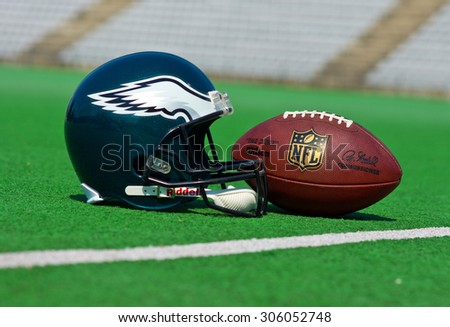 ZAGREB , CROATIA - 13 AUGUST 2015 -  Philadelphia eagles equipment , ball and helmet on the green playing field , product shot