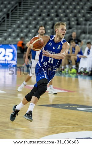 ZAGREB, CROATIA - AUGUST 27, 2015: The preparatory match ahead of the EuroBasket 2015 between Israel and Estonia. Estonian player Siim-Sander Vene running with the ball.