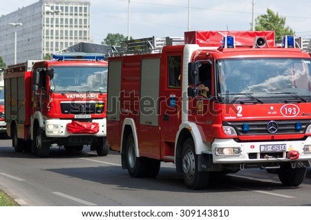 Zagreb, Croatia - August 1, 2015: Two red fire trucks during military parade rehearsal held in celebration of 20th anniversary of liberation of Croatia. - stock photo