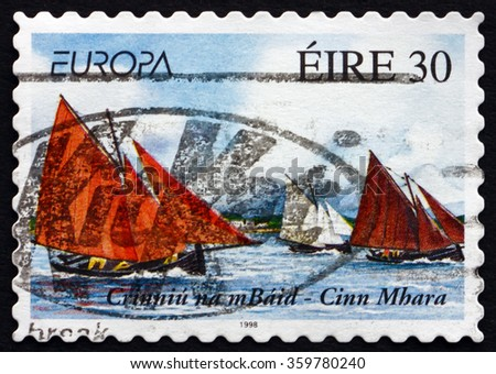 ZAGREB, CROATIA - DECEMBER, 2015: A stamp printed in Ireland shows Crinniu na mBald and Kinvara, Sailboats, Festival, circa 1998