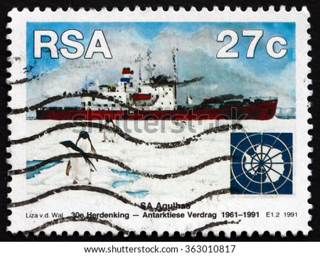 ZAGREB, CROATIA - DECEMBER, 2015: a stamp printed in South Africa shows SA Agulhas and Penguins, Antarctic Treaty, 30th Anniversary, circa 1991