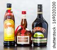 ZAGREB, CROATIA - DECEMBER 29, 2013: Bottles of coffee liqueur Kahlua, triple sec Grand Marnier and Bailey's Irish Cream, which in equal parts form B-52 cocktail, usually served layered in shot glass. - stock photo