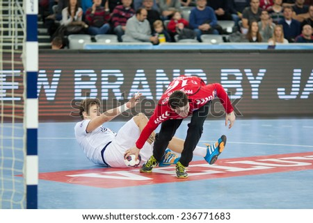 ZAGREB, CROATIA - DECEMBER 9, 2014: EHF Men's Champions League, match between HC Zagreb and HC Paris Saint-Germain. Filip IVIC (16) picking up the ball