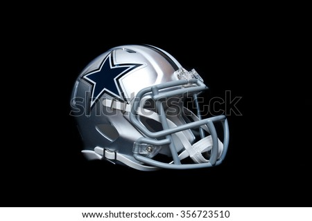 ZAGREB , CROATIA - 30 DECEMBER 2015 - NFL Dallas Cowboys helmet isolated on black background , product shot