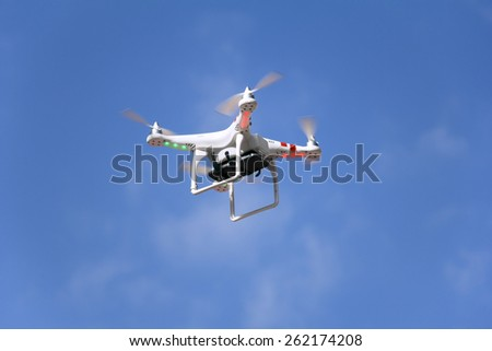ZAGREB / CROATIA, February 21, 2015: Airborne radio controlled quadcopter drone flying with cell phone camera mounted on a home made platform.  - stock photo