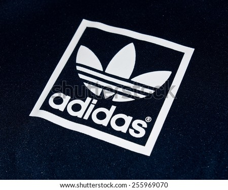 ZAGREB , CROATIA - 19 FEBRUARY 2015 - Close up logo of sport brand Adidas printed on textile , product shot