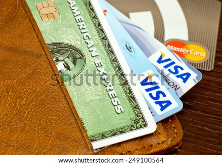 ZAGREB , CROATIA - 02 FEBRUARY 2015 - close up of credit cards , master card, VISA and american express in the leather wallet , product shot - stock photo