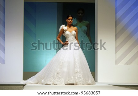 ZAGREB, CROATIA - FEBRUARY 19: Fashion model walks the runway in wedding dress on 'Wedding days' show, February 19, 2012 in Zagreb, Croatia.