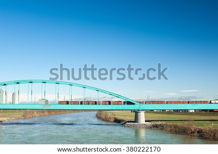 "Zagreb, Croatia - February 13, 2015: Green railway bridge ""Hendrix"" over Sava river in Zagreb and city skyline."