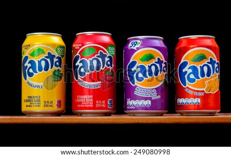 ZAGREB , CROATIA - 20 JANUARY 2015 - Few different cans of soft soda drink Fanta by coca-cola company at wooden table , product shot - stock photo
