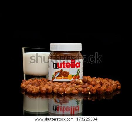 ZAGREB , CROATIA - JANUARY 24 ,2014 :  Nutella bottle glass of milk and hazelnuts on the table, product shot - stock photo