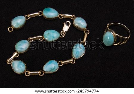 ZAGREB , CROATIA - JANUARY 20, 2015 - original larimar stone jewelry , ring and bracelet, from Dominican republic , product shot - stock photo